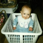 Christopher in clothes basket