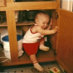 Chris playing in the cupboard