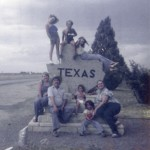 Chantel posing on top of the Texas state line with the family