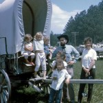Our family by a covered wagon