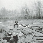 Grandpa Spencer on a river of logs