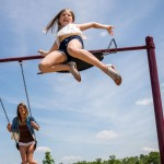 Girl-Jumping-off-Swing