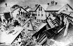 People stand atop houses among ruins after flooding in Johnstown, Pa., May 30, 1889. (AP Photo)