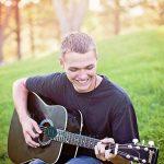 Caalab playing his guitar